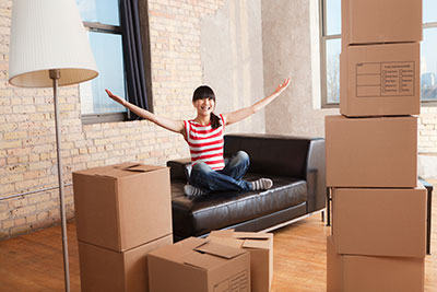 image of young lady after moving into first house