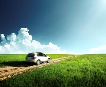 car driving through field
