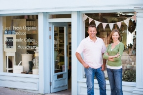 couple standing in front of business